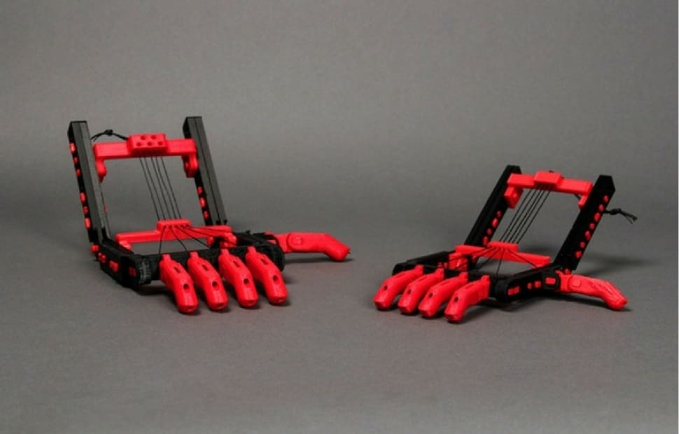 wo 3Dprinted black and red Robohand