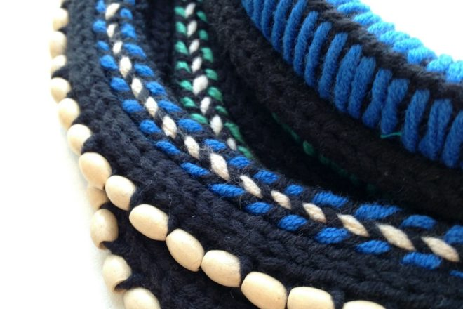Focus on details of Rhizom's knitted jewelry.
